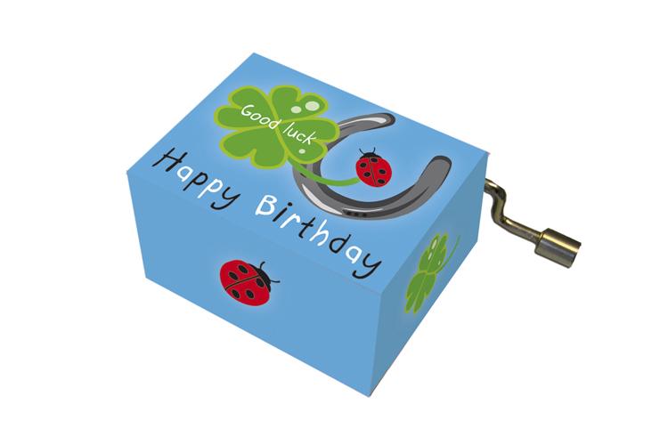 Boîte à musique: HAPPY BIRTHDAY fer à cheval, feuille de trèfle, coccinelle,